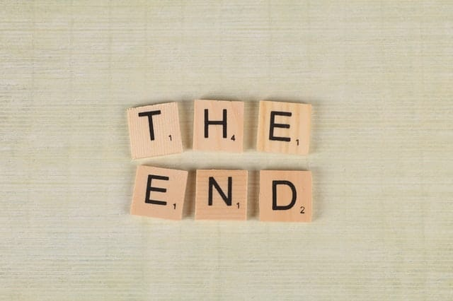"Close up of scrabble tiles forming the words ""The end"""